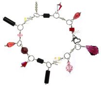 This Swarovski Crystal Charm bracelet is a very limited edition  item that was created on sterling silver and groups together many antique and rare Swarovski crystals.  The charm bracelet isone of the most unusual of all the designs as it uses some of the most rare Elements in the amore collection.