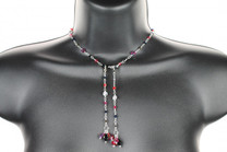 Handcrafted using sterling silver in a wire wrapping technique.  This necklace is created using a variety of rare, antique, and modern day Swarovski crystals.  The simple single strand design makes this the perfect everyday item.