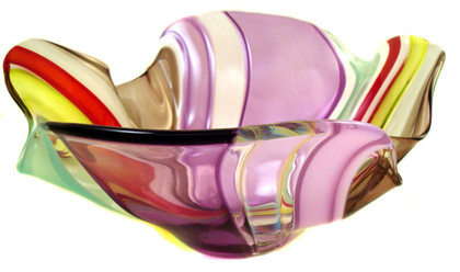 Beautiful color scheme in a free form floppy bowl.  The adorned collection is perfect for introducing color into your decor