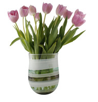 green and white hand blown glass vase displayed with pink tulip arrangement