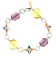 Gold wire wrapped bracelet with rare purple and yellow swarovski crystal