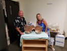 Jason and Amy getting the Bar Vases set up ready to go