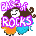 A goofy cartoon Ariel with the words BAGS OF ROCKS.