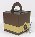 Medium Cube Box With Handle shown in Shimmering Chocolate. Box Belt & Foil Seal not included.