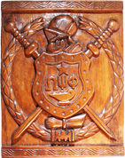 OMEGA PSI PHI HAND CARVED ESCUTCHEON