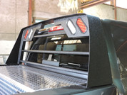 Aluminum Contour Headache Rack installed on 2014 Dodge Mega-Cab. Shown with Optional Spray on Bed-Liner. Comes standard with LED Lights. (Shown with AT45TT). 1-800-773-3047