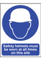 Safety sign Safety helmets must be worn at all times on this site