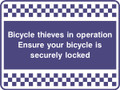Bicycle thieves in operation security sign