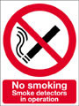 No smoking smoke detectors in operation sign