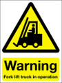 Warning fork lift truck in operation sign