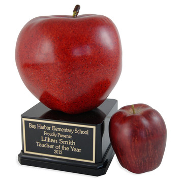 Jumbo Apple trophy pictured next to actual sized apple