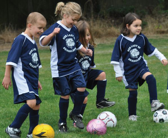 Bulldogs soccer kids in Code Four Athletics custom reversible jersey