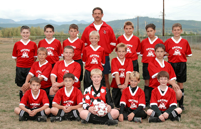 Youth soccer team in Code Four Pioneer soccer jerseys.