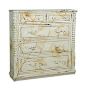 "Vintage Blanc with subtle ochre floral and vine artwork hand-painted on solid wood chest with spindle trim. Finished hardware. 48"" High  48"" Wide 12"" Deep"