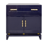 NAVY LACQUER (1) DRAWER, 2 DOOR CABINET WITH GOLD LEAFED BAMBOO HARDWARE AND GOLD LEAFED METAL DETAIL ON BASE.