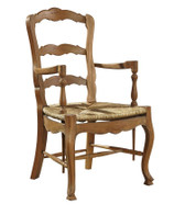 Solid mahogany country French ladderback chair Rush seat hand woven onto frame Shaped back and seat rails with cabriole leg terminating in block foot This typical provincial chair features hand shaping and hand carved beading.