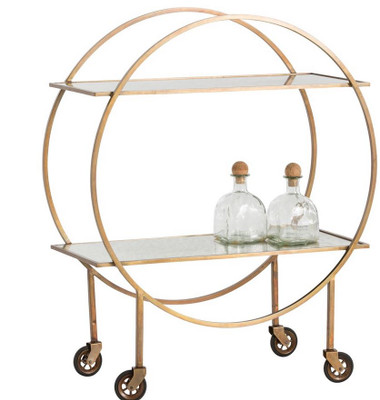 A Classic Deco statement piece, this bar features two shelves floating between parallel circles. The four legs each have rubber caster wheels, and the square iron tube frame is plated in antique brass. Shelves feature hand-applied antiqued mirror pattern which will vary. Designed for display and storage; not intended for commercial use.