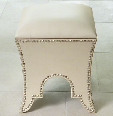 A white leather moroccan pouf from Global Views