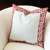 The bezel border pattern is inspired by an antique air vent register. Realized in an embroidered pattern in a contrasting color around a cotton pillow. Pattern on front and back