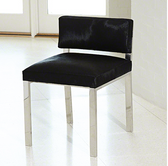 An updated version of Billy Haines classic gown chair, our version gets a mid-century twist with a stainless steel frame and black colored hair hide leather cushions.