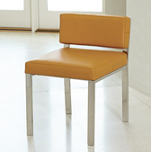 Camel colored and stainless steel armless and low-back chair