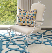 Global Views White Forest Chair is an upholstered arm chair with a white frame and white cushions