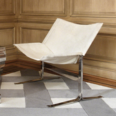 A cantilever, hair on hide, white chair from Global Views.