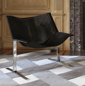 A cantilever, black, hair on hide chair from Global Views.