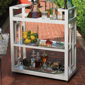 "Reminiscent of the entertainment of the mid-century, the Grid Block Bar Cart captures the geometric architecture and furniture of the time period. The matte white lacquer finish brings a sophisticated elegance to this modern design. Features integrated handles, three tiers of removable glass shelves, and fully rotational cast brass wheels.  36""L x 16""W x 42""H"