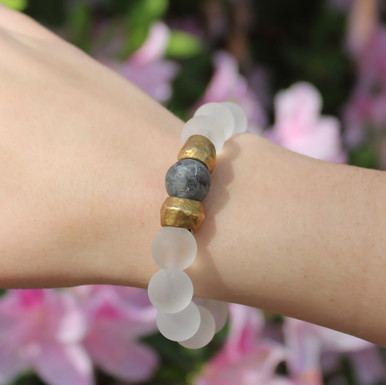 Clear Quartz (uplifting and clarity) and Larvikite (day-to-day) Stone Bracelet. Hand-molded Brass Accent Bead for natural good. Stretch Bracelet. 7 inches.