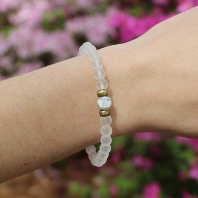 Skinny Clear Quartz/Howlite (amplifying clarity and calming) Stone Bracelet. Hand-molded Brass Accent Bead for natural good. Stretch Bracelet. 7 inches.