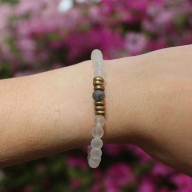 Skinny clear quartz and larvikite (amplifying clarity and cleansing) Stone Bracelet. Hand-molded Brass Accent Bead for natural good. Stretch Bracelet. 7 inches.