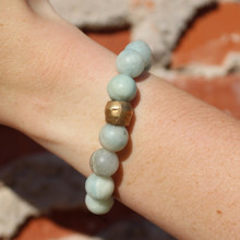 Aquamarine Stone Bracelet. Hand-molded Brass Accent Bead for natural good. Stretch Bracelet. 7 inches.