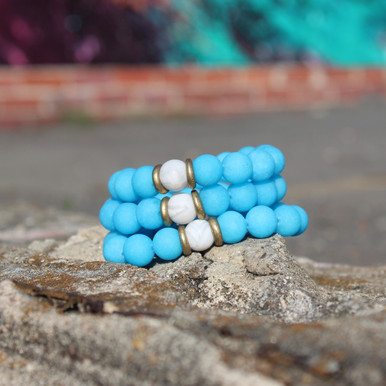It is all about the STATEMENT this season bigger and bold bracelets with simple chain, enjoy this three pack of bracelets go minimal or max out your wristwear. White Lace Agate and Jade Stone. Brass. Stretch Bracelet. 7inches.