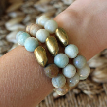It is all about the STATEMENT, go BOLD with BRYN+MCKENNA's personal growth bracelets in Amazonite. Amazonite Stone=Positive. Brass=Natural Good. Brass Bead Shape=Personal Growth. Stretch Bracelet. 7inches.