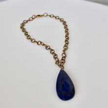 Relax and enjoy the conversation with this stone necklace can be wore as a choker or necklace. Steele Necklace. Lapis Stone. 18 inches in length.