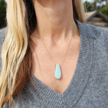 Spread love and kindness at work and home with this gorgeous stone. Amazonite makes everything better with it playful lure of loving energy  wear alone or layer. Gold filled chain 18 inches.
