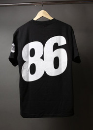 "What Monsters Do ""86"" Tee"