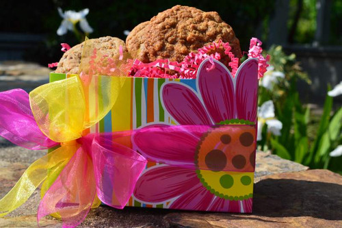 Gourmet cookies in this bright flower basket are sure to make mom smile.