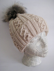 Asiatic raccoon pom-pom hat