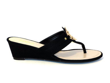 The Dana2 - cute thong wedge sandals come in black with a gold medal medallion. This is great basic for your summer wardrobe!