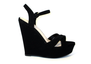 The Ava is a black platform wedge sandal, perfect for your light summer dress, day or night, or try pairing it with your favorite leggings, shorts, or skirts.