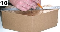 Lay on a table and draw a horizontal line across to mark off the excess cardboard on both sides.