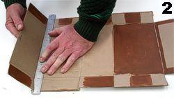 Use a metal ruler to help fold the cardboard neatly