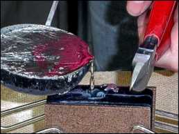 Heat the metal, and pour it into the mould, tapping it gently as you pour.