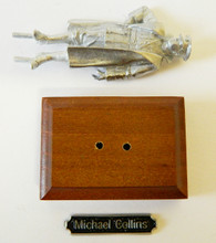 Unassembled metal figure of Michael Collins.