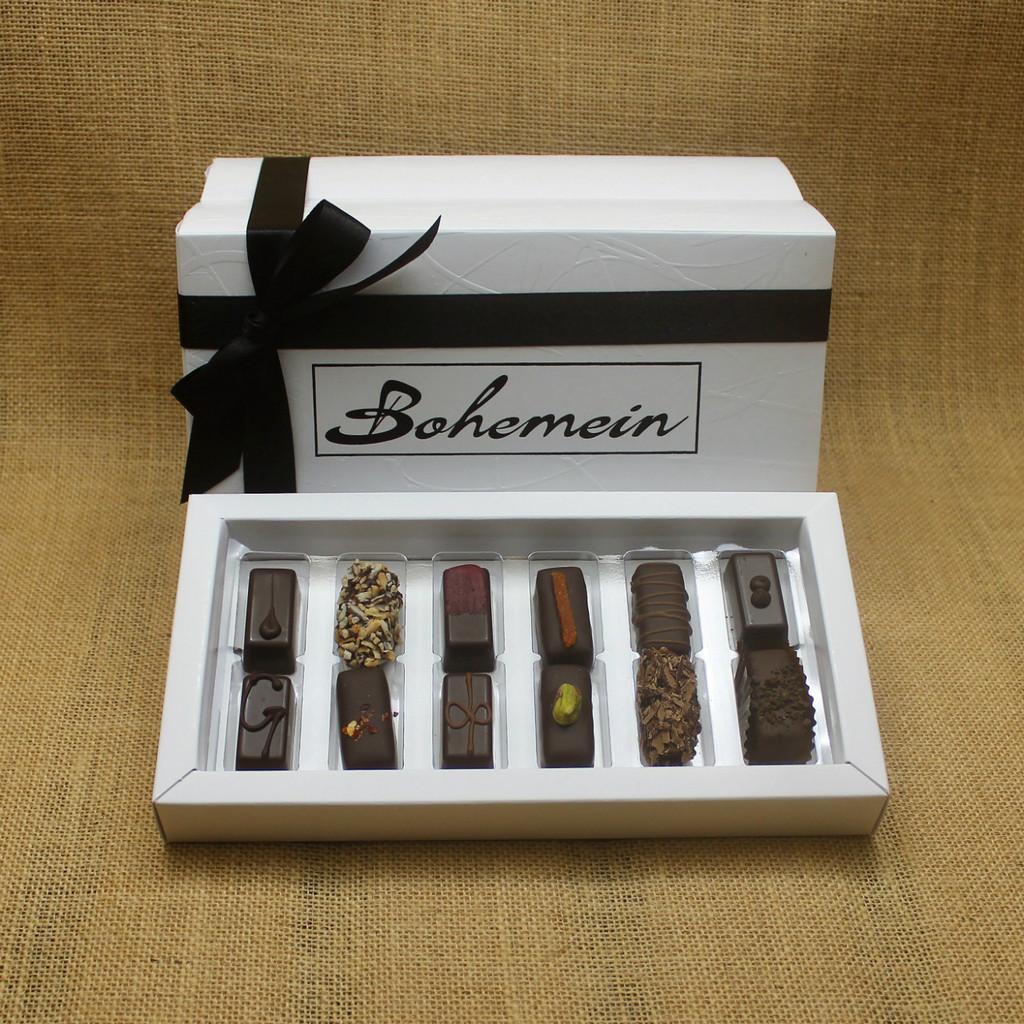 Bohemein 12 Dark  Chocolates Gift Box includes: Melting Passion Ganache, Coconut Cream Truffle, Raspberry Ganache, Rosemary and Apricot Ganache, Noisette (Hazelnut), Creme de Menthe Fondant, Ginger Caramel, Chilli Ganache, Vanilla Cream - Dark, Pistachio Marzipan, Seventy Truffle, Cocoa Nib Caramel