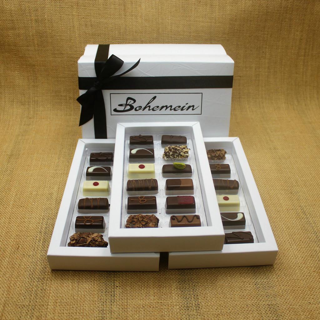 Bohemein Gift Box with 36 Non Alcohol Flavoured Chocolates including: Seventy Truffle x3, Vanilla Cream - Dark x3, Noisette (Hazelnut) x3, Strawberry Ganache x3 ,Pineapple Black Pepper Ganache x3, Ginger Caramel x3, Maple Cream x3, Raspberry Ganache x3, Chocolate Caramel x3, Pistachio Marzipan x3, Coconut Cream Truffle x3, Balsamic Vinegar and Honey Ganache x3
