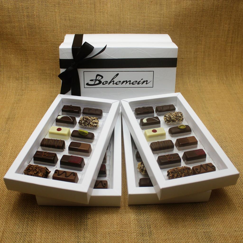 Bohemein Gift Box with 48 Non Alcohol Flavoured Chocolates including: Seventy Truffle x4, Vanilla Cream - Dark x4, Noisette (Hazelnut) x4, Strawberry Ganache x4 ,Pineapple Black Pepper Ganache x4, Ginger Caramel x4, Maple Cream x4, Raspberry Ganache x4, Chocolate Caramel x4, Pistachio Marzipan x4, Coconut Cream Truffle x4, Balsamic Vinegar and Honey Ganache x4