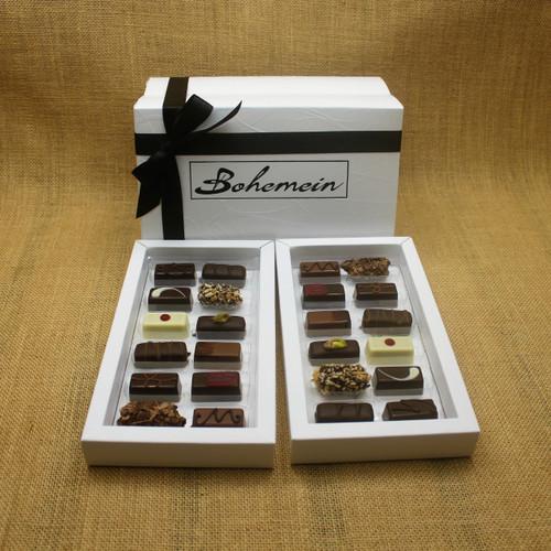 Bohemein Gift Box with 24 Non Alcohol Flavoured Chocolates including: Seventy Truffle x2, Vanilla Cream - Dark x2, Noisette (Hazelnut) x2, Strawberry Ganache x2 ,Pineapple Black Pepper Ganache x2, Ginger Caramel x2, Maple Cream x2, Raspberry Ganache x2, Chocolate Caramel x2, Pistachio Marzipan x2, Coconut Cream Truffle x2, Balsamic Vinegar and Honey Ganache x2